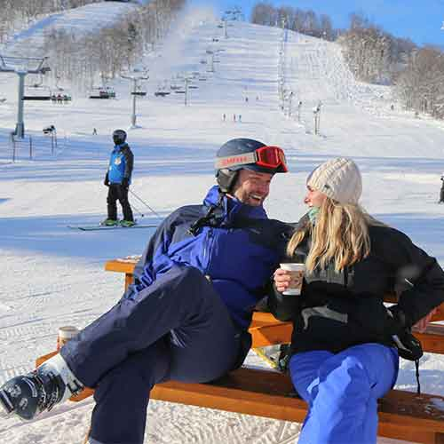 Couple at the base of Boyne Mountain Resort